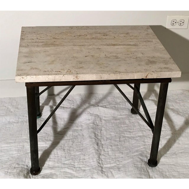 Beautiful slab of travertine sits atop metal legs with cross support. Some definite oxidation to the legs but it gives...