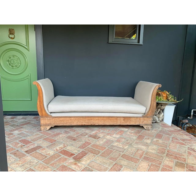Designer refurbished day bed by stripping off the original dark brown finish and letting the natural oak shine through....