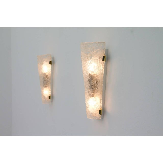 Pair of Hillebrand brass and glass wall sconces, 1965. Very good condition.