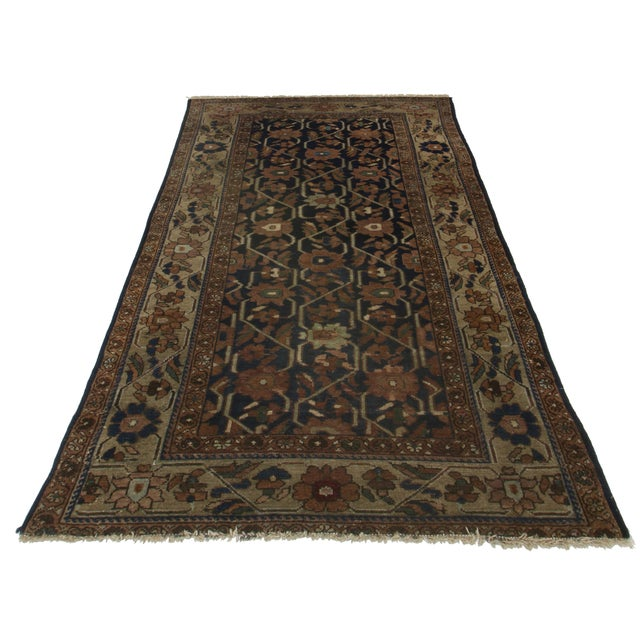 Hand Knotted Wool Persian Hamedan rug with floral design.