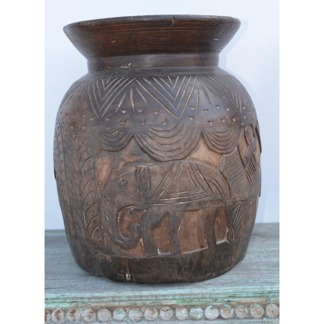 Vintage Indian hand carved vase. The reliefs are depictions and stories of village life. The vases were then used for...