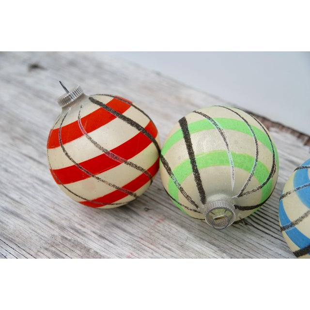 Delightful set of West German Christmas ornaments with hand painted colorful stripes and black mica swirls. In fabulous...