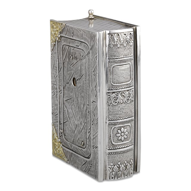 The entire case of this delightful German bird box is crafted of sterling silver in the form of a box. Yet, it is what is...