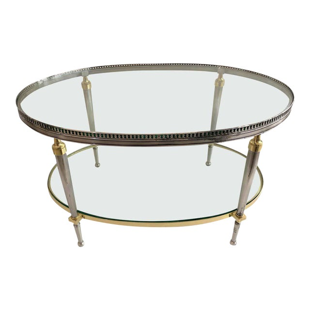 Trouvailles Steel Glass and Brass Oval Cocktail Table For Sale