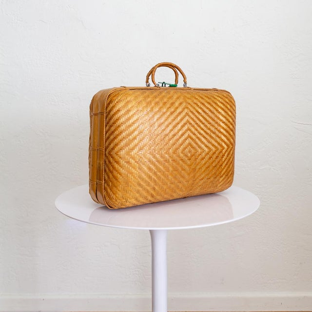 Japanese bamboo luggage features a soft bodied, rounded suitcase design in a nice size for decorative storage or...