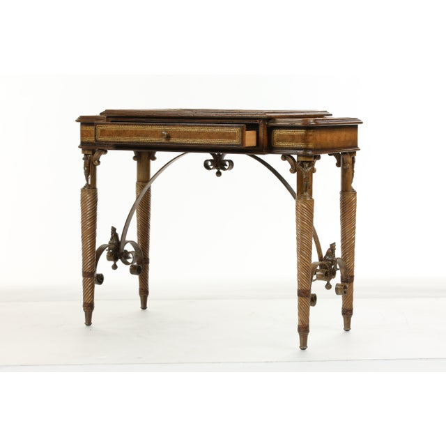 Maitland Smith ornate game table with a precise design. Made in the 2000s.