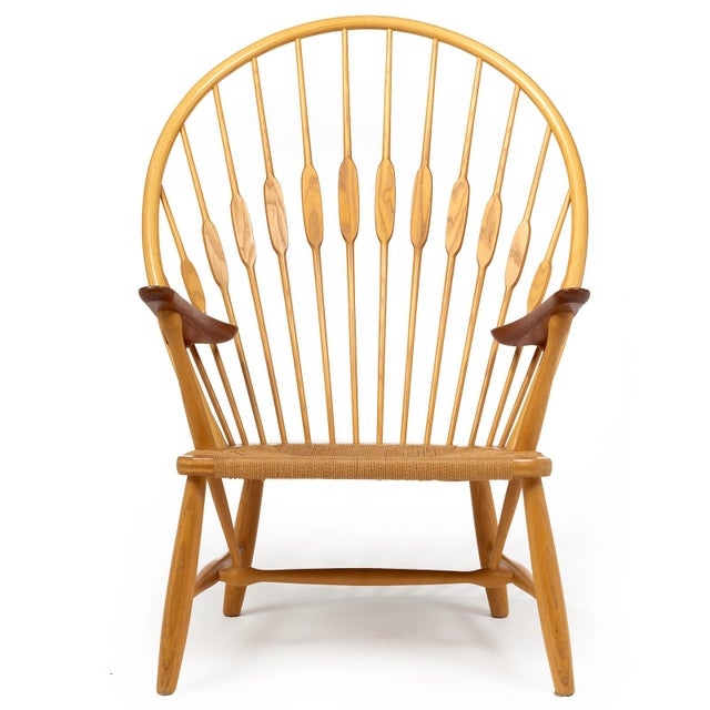 A bench made lounge chair in steam bent ash and teak with Danish papercord woven seat. Designed by Hans Wegner and...
