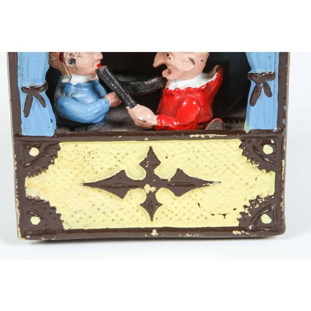 """Hand-painted cast iron mechanical bank """"Punch and Judy Bank."""" It operates as follows: Pull-out the lever on the right side..."""