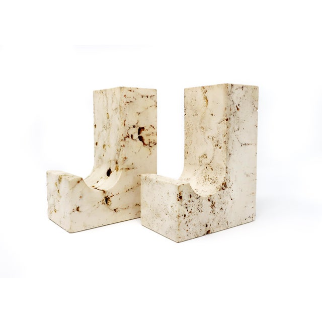 A pair of vintage carved travertine bookends in the style of Fratelli Mannelli, circa 1960s. Likely Italian, this unsigned...