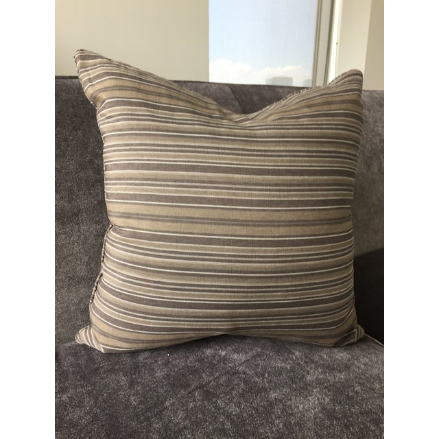 "18"" x 18"" throw pillow in a Christian Liaigre linen stripe. Pillow has self welt and 50/50 fill. Opposite corners measure..."