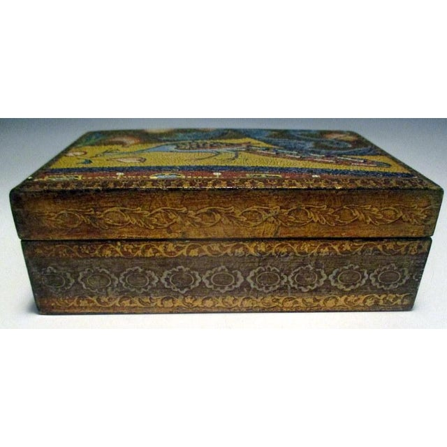 Lovely little vintage Florentine box with decorative scene of a peacock on the top and stylized decorations all around....