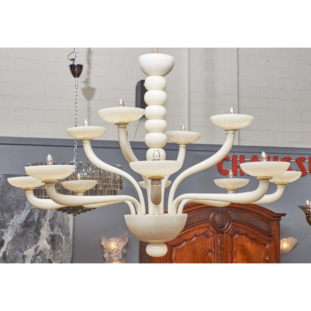Ivory Murano glass chandelier with twelve branches. We love the classic lines and modern details of this hand-blown...