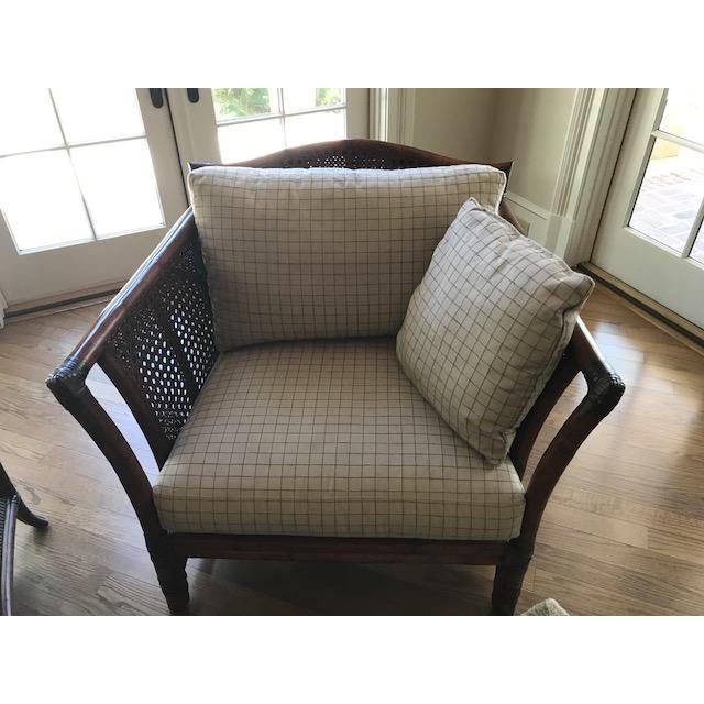 Beautiful Ficks Reed Chair with a dark brown finish and black accents. Great neutral fabric in browns and back. I also...