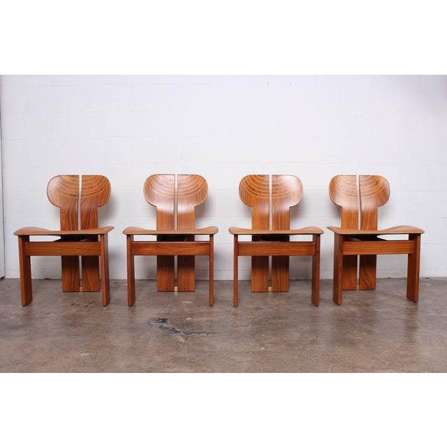 A set of four Africa chairs in pallisander, ebony, leather and brass. Designed by Afra & Tobia Scarpa for Maxalto.
