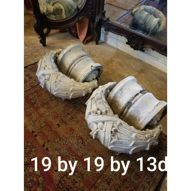Two wonderful antique neoclassical style molded zinc architectural fragments....great to attach a wire to and hang on a...