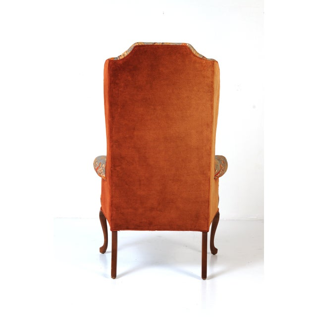 Show-stopping pair of tall wingback chairs in original quilted peacock fabric. Back and sides are rust velvet. The...