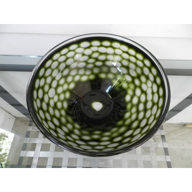 This bowl is absolutely stunning! This bowl is mouth blown and hand cut glass. The rim is unbalanced above the sparkling...