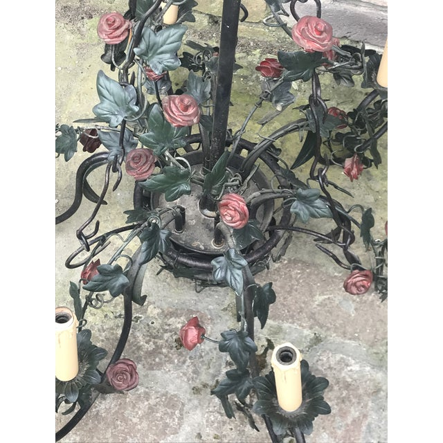Gorgeous vintage six arm chandelier. In an Italian tole design featuring red roses and dark green ivy. Will need to be re-...