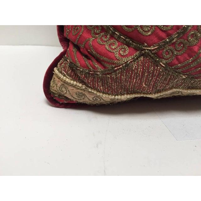 Pair of antique silk pillows with metallic threads and dark burgundy velvet backing. Pair of handmade silk pillows made...