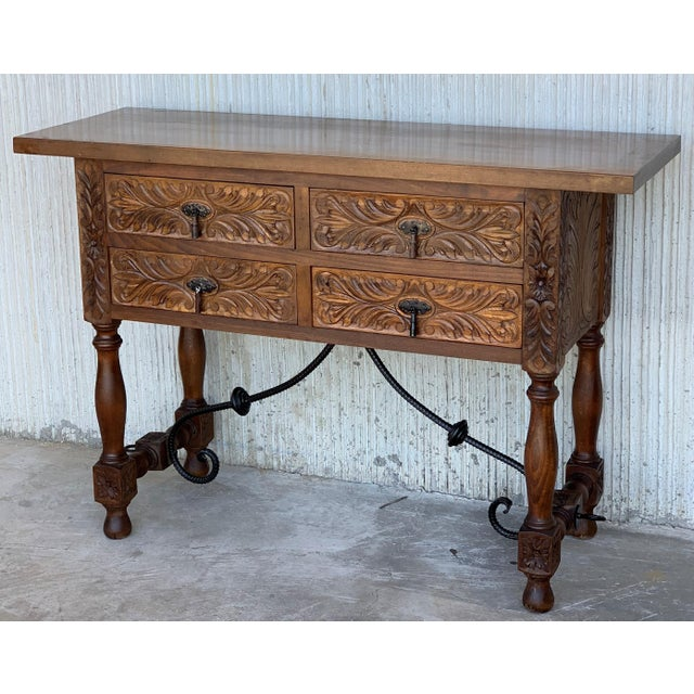 About 20th Spanish carved walnut console sofa table with four drawers and iron stretcher. You can use like a commode or...