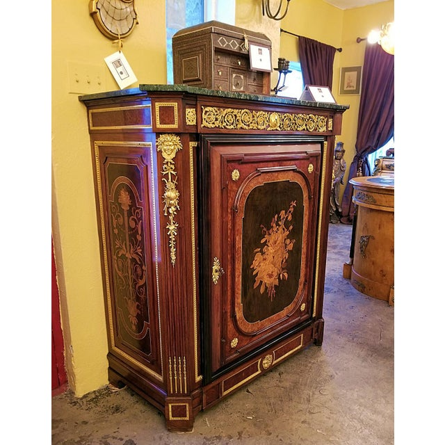 Presenting a gorgeous late 19th century French Louis XVI style cabinet of the quality of Grohe Freres or Linke. From circa...