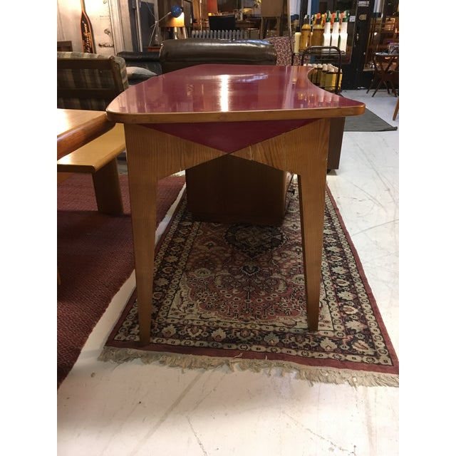 Unusually brilliant mid-century Italian desk in oak and red laminate. Not quite an executive desk, but way more than a...