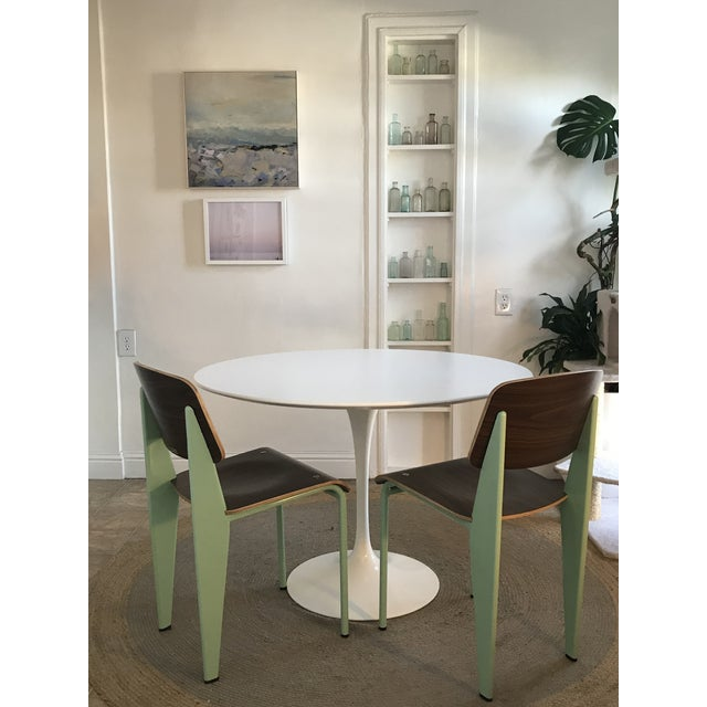 Prouvé style dining chairs from Industry West in walnut and peppermint. In nearly perfect condition. Haven't been used,...