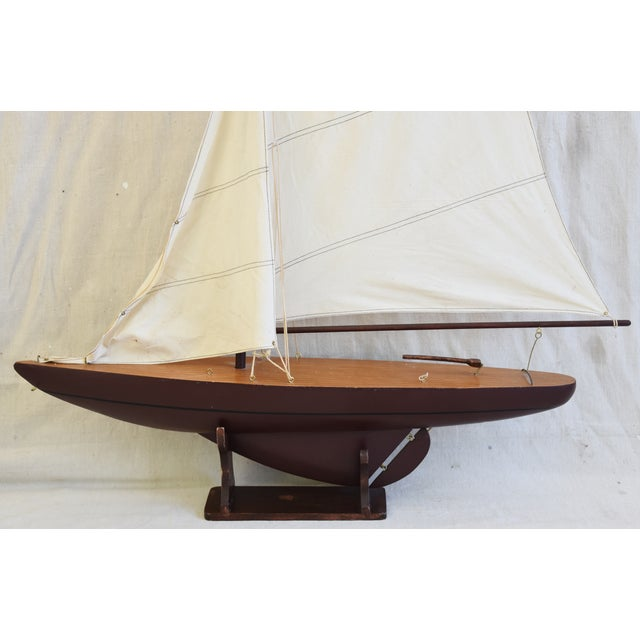 Vintage nautical sailing ship boat model with stand and fabric sails. No maker's mark. Some wear consistent with age and use.