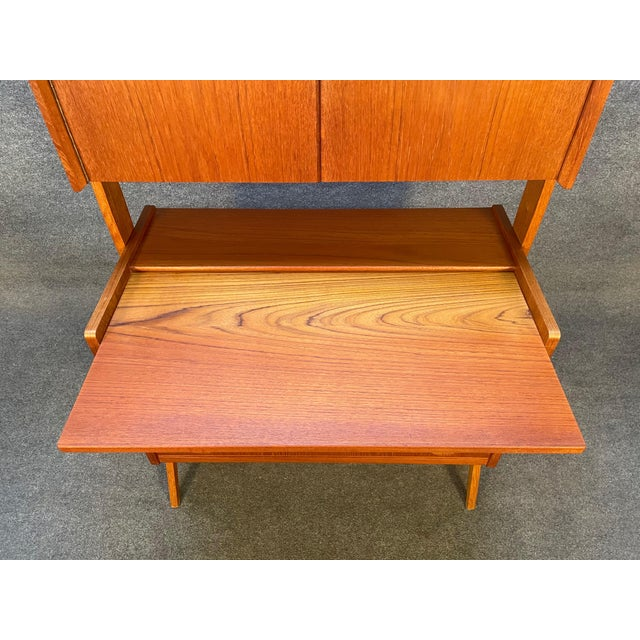 Here is a rare scandinavian modern secretary/desk/vanity manufactured in Denmark in the 1960's that was recently imported...