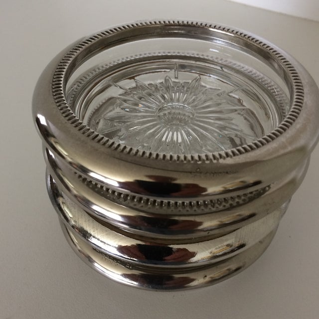 Each individual coaster measures 4 inches wide by 1 inch high. Made in Italy by Leonard.
