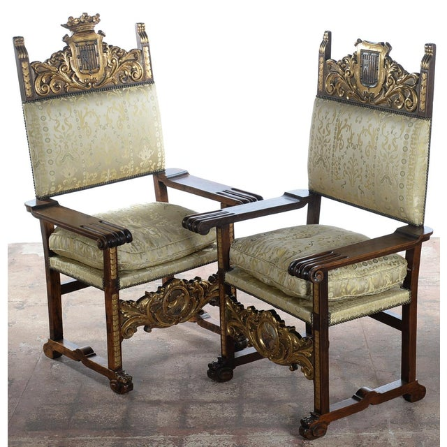 Renaissance Coat of Arm Large Side Arm Chairs - Pair. From the Melanie Griffith & Antonio Banderas Estate. In excellent...