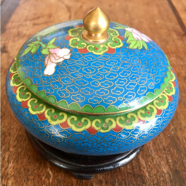 Beautiful vintage Chinese cloisonne trinket box with wooden base. Colorful, floral design. This piece was bought in the...