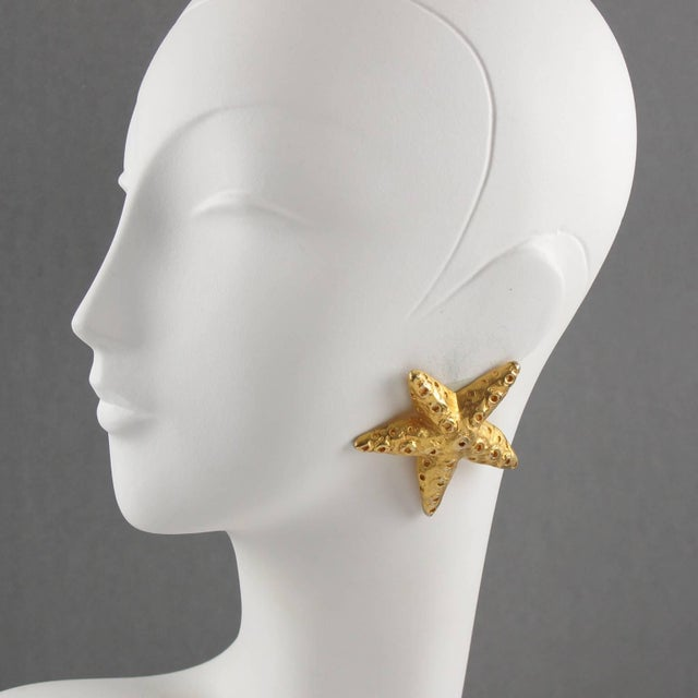 Lovely Christian Lacroix Paris signed clip-on earrings. Featuring oversized dimensional starfish in shinny gilt metal with...