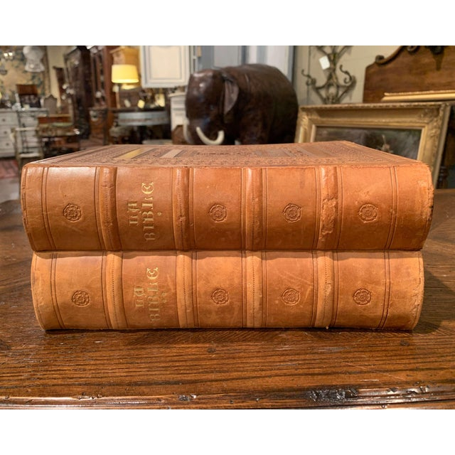 These two holy Bible books with brown leather covers were created in Marseille, France, dated 1953, each of the two books...