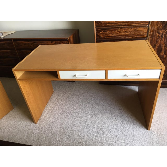 This is sleek and modern teak modular desk with two white laquer sliding drawers from Denmark. The two sliding drawers can...