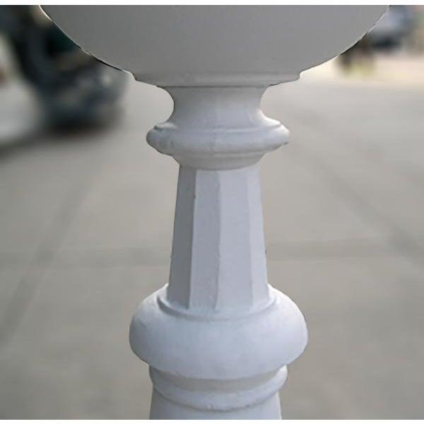 Late 20th century, cast iron birdbath copied from 19th century original. Tazza form basin on partially fluted baluster...
