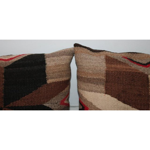 This is an amazing pair of negative or positive broken star pattern bolster pillows. These Navajo weaving greats have dark...