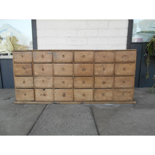 Hard to find, antique pine Apothecary cabinet with 24 drawers. Some drawers have dividers and some never had dividers....