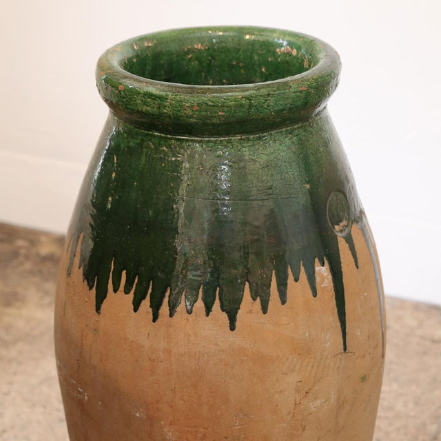 Green Glaze Terracotta Jar with tall, tapered body and makers mark from late 19th century Provence, France.