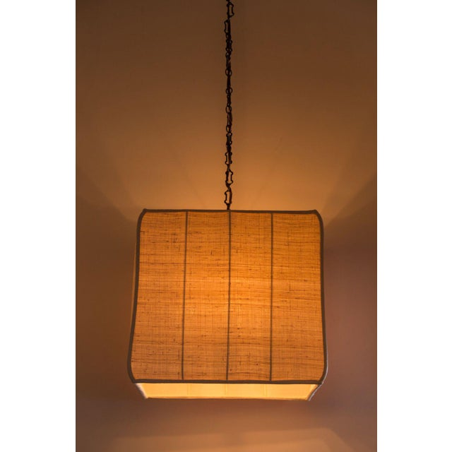 Paul Marra Asian-Inspired Four Light Shaded Pendant. Full metal armature in oil-rubbed bronze. Subtle texture and a...