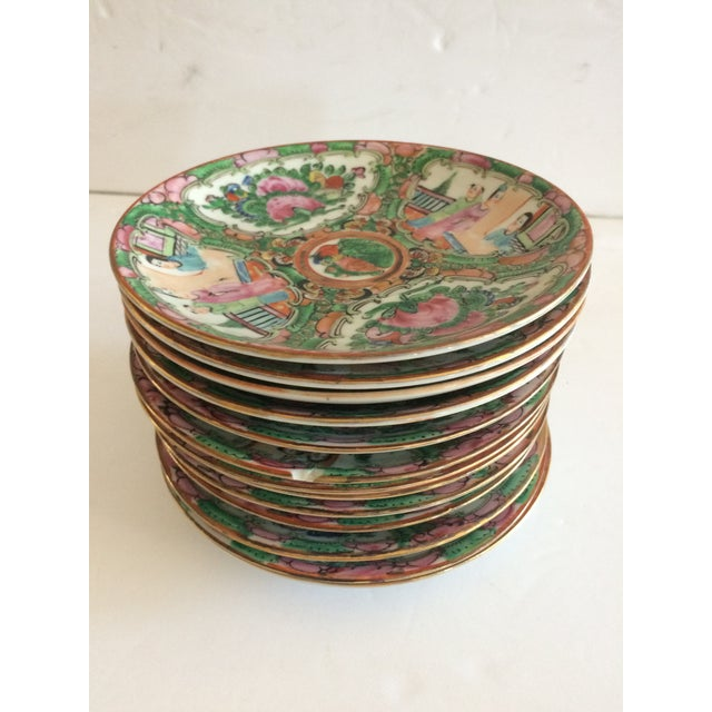 "Beautiful set of 13, 5.5"" Rose Medallion saucers. Some ""flea bites"", but normal for the age."
