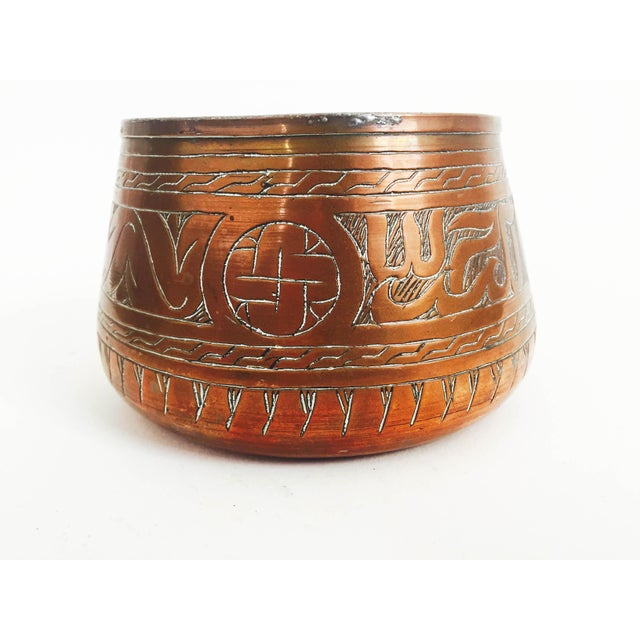 A gorgeous vintage copper cache pot with an intricate hand etched design.
