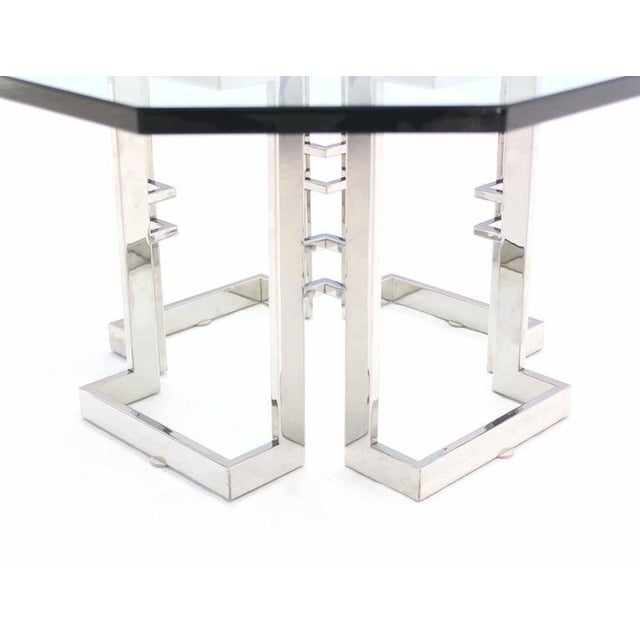 Mid Century Modern square chrome base with close to occasional shape glass top coffee table in style of M. Baughman.