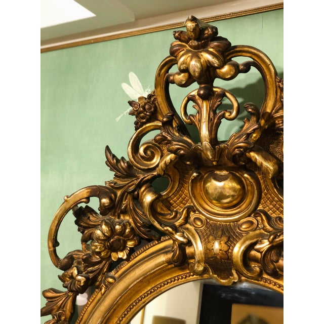 This an absolutely Stunning Antique mirror that is trumeau style, meaning it has a handcrafted panel (both carved and...