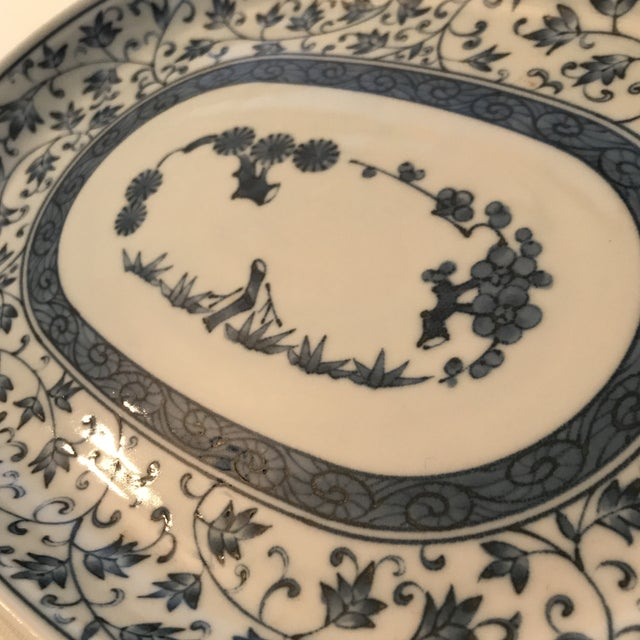 Oval shaped Chinese blue and white porcelain dish with hand painted floral decoration. Perfect for entry catch-all or...