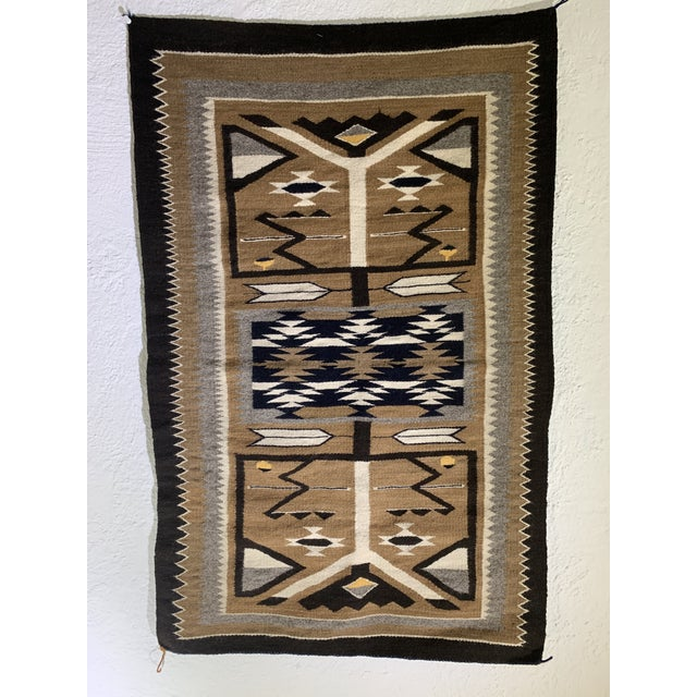 Navajo Pictorial Rug in grey, black, blue, beige and white. Geometric design featuring arrow motif throughout. Acquired at...