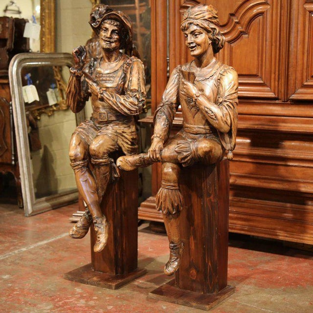 Bring new friends to your game room with this exceptional pair of antique fruitwood figures from Italy! The card players...
