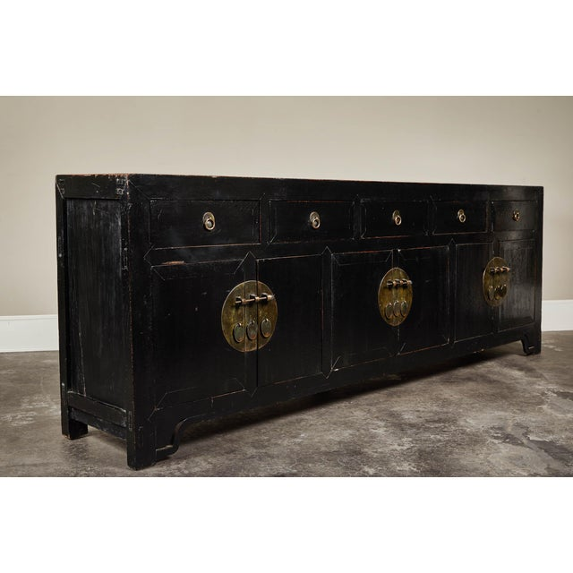 An 18th century five-drawer, six-door black lacquer cabinet from Hebei. Made from elm wood. Remarkable scale, makes this...