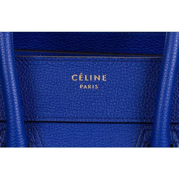 Celine brand new micro luggage handbag in indigo blue calfskin with interior suede lining. Zipper closer and outer zipped...