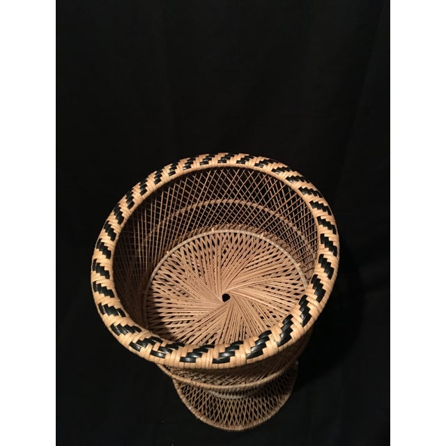 This vintage wicker rattan pedestal planter or basket could be used to hold your favorite plant or use in your bathroom or...